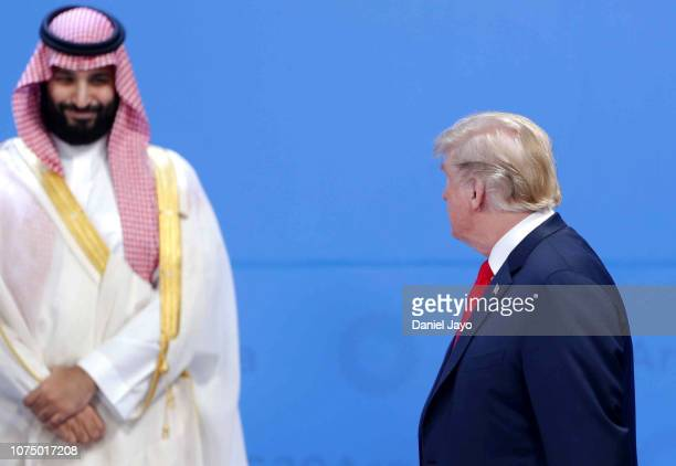 President Donald Trump looks over at Crown Prince of Saudi Arabia Mohammad bin Salman al-Saud as they line up for the family photo during the opening...