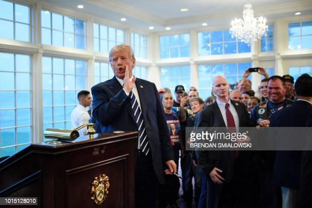 US President Donald Trump makes a comment to the press about former aid Omarosa Manigault Newman while meeting with supporters during a Bikers for...