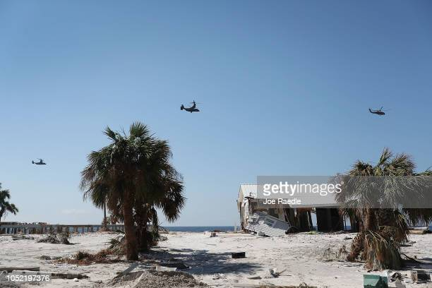 President Donald Trump makes a flyover as he tours the devastation caused by Hurricane Michael on October 15 2018 in Mexico Beach Florida The...