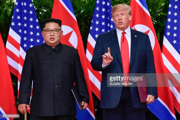 President Donald Trump makes a statement before saying goodbye to North Korea leader Kim Jong Un after their meetings at the Capella resort on...