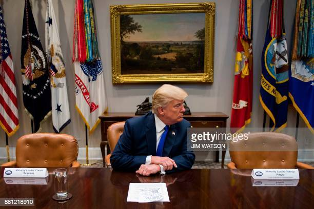 President Donald Trump makes a statement from the Roosevelt Room next to the empty chairs of Senate Minority Leader Chuck Schumer DNew York and House...
