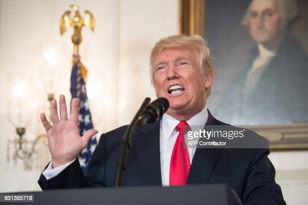 US President Donald Trump makes a statement in the Diplomatic Room at the White House in Washington DC on August 14 2017 US President Donald Trump...