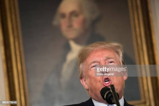 President Donald Trump makes a statement on the administration's strategy for dealing with Iran, in the Diplomatic Reception Room in the White House,...