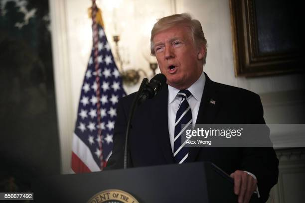 S President Donald Trump makes a statement on the Las Vegas mass shooting at the Diplomatic Room of the White House October 2 2017 in Washington DC...