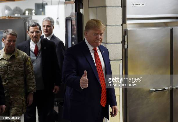President Donald Trump makes a surprise Thanksgiving day visit with US troops stationed at Bagram Air Field, on November 28, 2019 in Afghanistan.