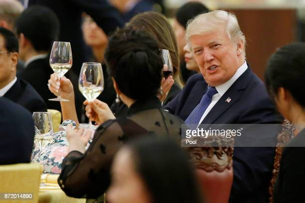 S President Donald Trump makes a toast during a state dinner hosted by his Chinese counterpart Xi Jinping at the Great hall of the People on November...