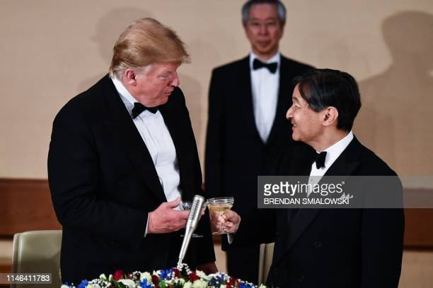 President Donald Trump makes a toast with Japan's Emperor Naruhito during a state banquet at the Imperial Palace in Tokyo on May 27, 2019.