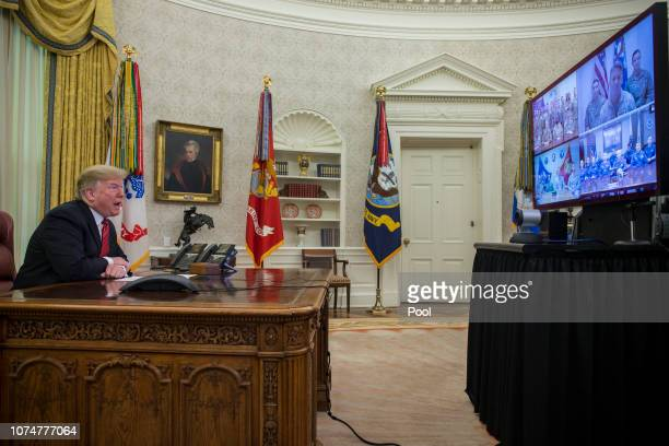 S President Donald Trump makes a video call to service members from the Army Marine Corps Navy Air Force and Coast Guard stationed worldwide in the...