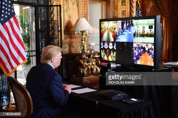 President Donald Trump makes a video call to the troops stationed worldwide at the Mar-a-Lago estate in Palm Beach Florida, on December 24, 2019.