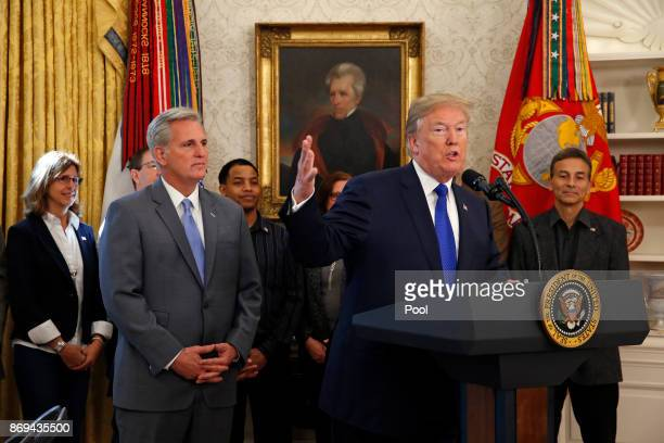 US President Donald Trump makes an announcement on jobs in the Oval Office of the White House on November 2 2017 in Washington DC At left is Rep...