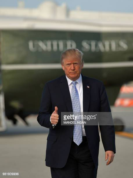 US President Donald Trump makes his way from Marine One to board Air Force One before departing from Los Angeles International Airport in Los Angeles...