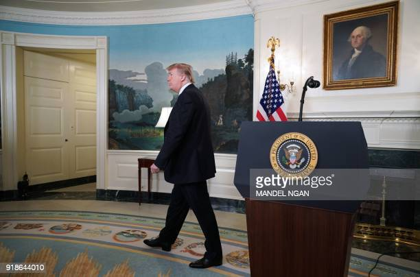 US President Donald Trump makes his way from the Diplomatic Reception Room after speaking on the Florida school shooting at the White House on...
