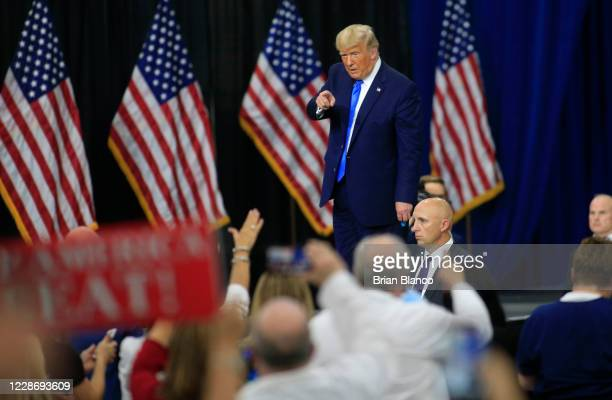 S President Donald Trump makes his way off stage after signing an executive order following his remarks on his healthcare policies on September 24...