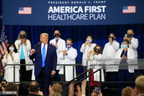 President Donald Trump makes his way off stage after signing an executive order following his remarks on his healthcare policies on September 24,...