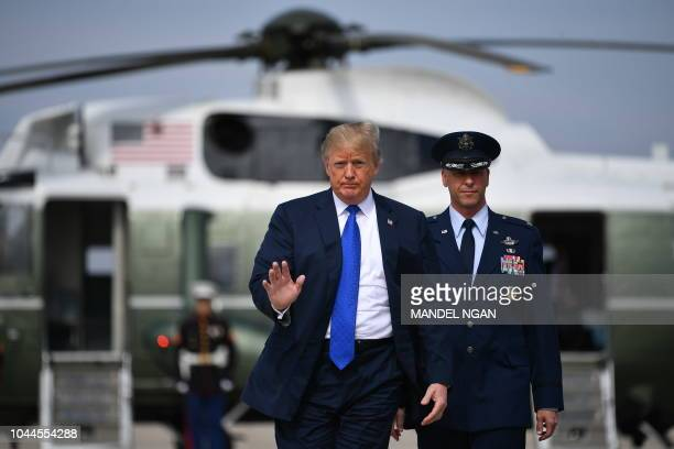 US President Donald Trump makes his way to board Air Force One before departing from Andrews Air Force Base in Maryland on October 2 2018 Trump is...