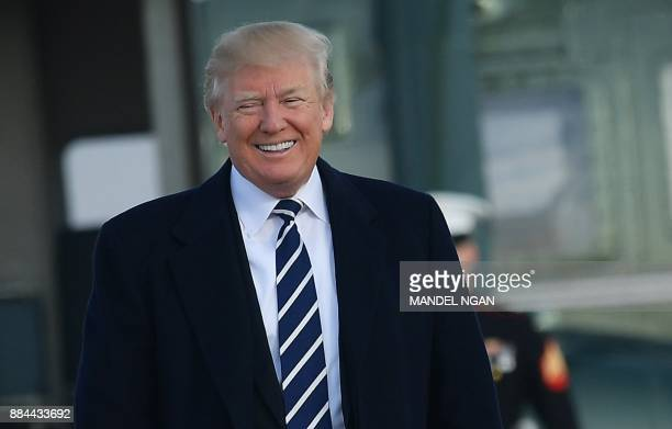US President Donald Trump makes his way to board Air Force One before departing from Andrews Air Force Base in Maryland on December 2 2017 Trump is...