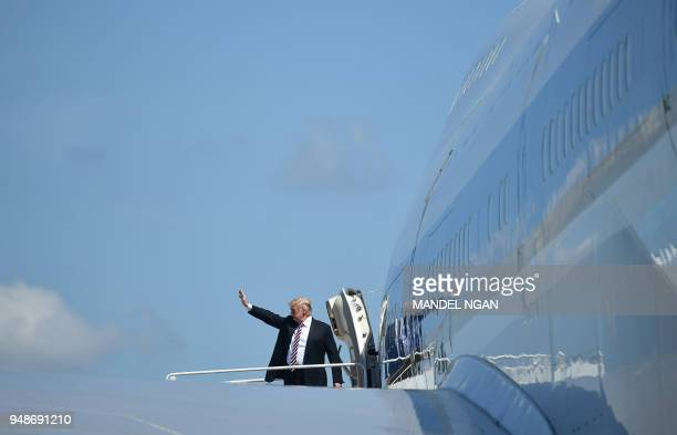 President Donald Trump makes his way to board Air Force One before departing from Palm Beach International Airport in West Palm Beach Florida on...