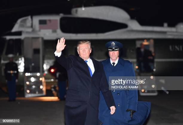 US President Donald Trump makes his way to board Air Force One on January 24 2018 at Andrews Air Foce Base in Maryland en route to to Davos...