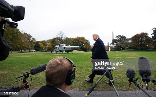 President Donald Trump makes his way to board Marine One from the South Lawn of the White House in Washington DC on November 2 2018 Trump will be...