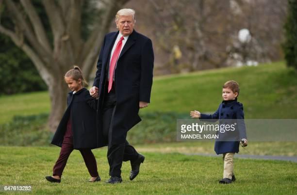 US President Donald Trump makes his way to board Marine One with grandchildren Arabella Kushner and Joseph Kushner from the White House in Washington...