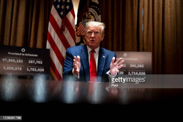 S President Donald Trump makes remarks as he attends a meeting with the Arkansas Governor Asa Hutchinson and Kansas Governor Laura Kelly in the...