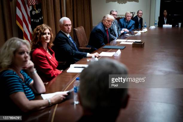 President Donald Trump makes remarks as he meets with U.S. Tech Workers and signs an Executive Order on Hiring Americans, in the Cabinet Room of the...