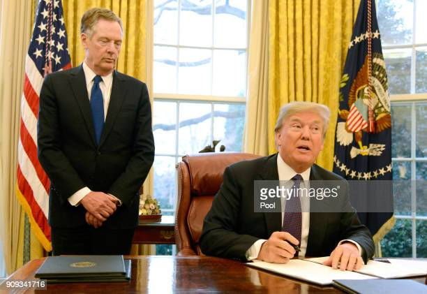 President Donald Trump makes remarks as he signs a Section 201 action as US Trade Representative Robert Lighthizer witnesses in the Oval Office at...