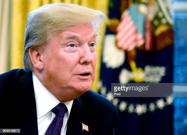 President Donald Trump makes remarks as he signs a Section 201 action in the Oval Office at the White House January 23 in Washington DC The...