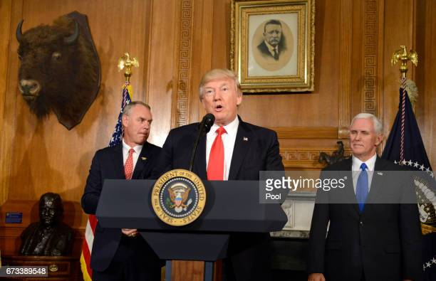 US President Donald Trump makes remarks as Interior Secretary Ryan Zinke and Vice President Mike Pence listen prior to signing an 'Antiquities...