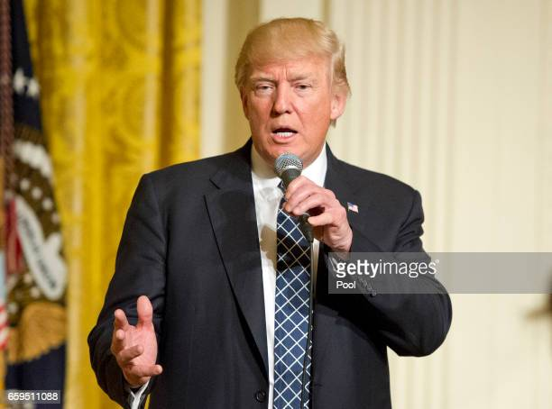 US President Donald Trump makes remarks at a reception for US Senators and their spouses in the East Room of the White House on March 28 2017 in...