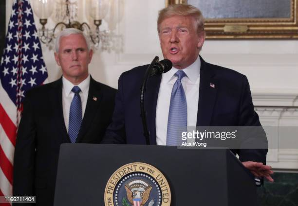 President Donald Trump makes remarks in the Diplomatic Reception Room of the White House as U.S. Vice President Mike Pence looks on August 5, 2019 in...
