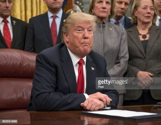 S President Donald Trump makes remarks in the Oval Office prior to signing the bipartisan Interdict Act a bill to stop the flow of opioids into the...