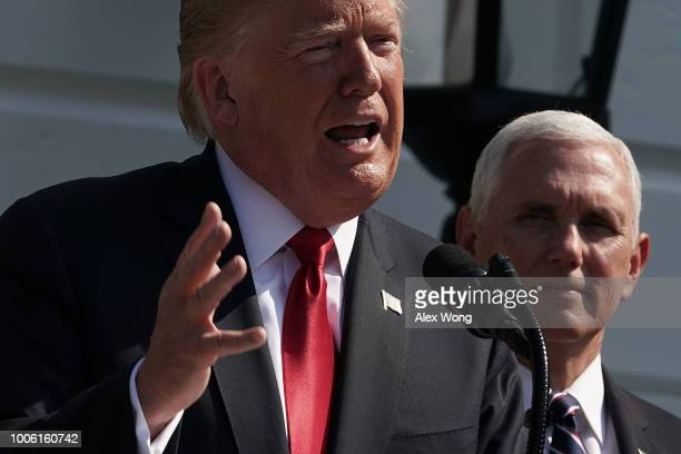 S President Donald Trump makes remarks on the economy as Vice President Mike Pence looks on July 27 2018 at the South Lawn of the White House in...
