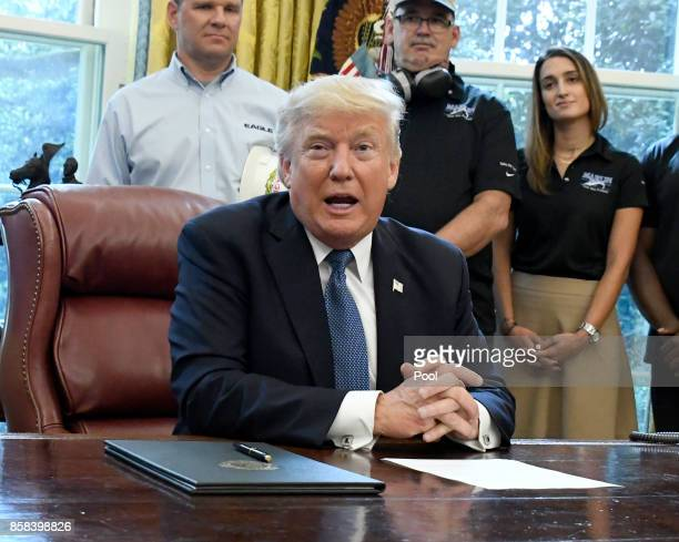 US President Donald Trump makes remarks prior to signing a National Manufacturing Day Proclamation in the Oval Office of the White House on October 6...