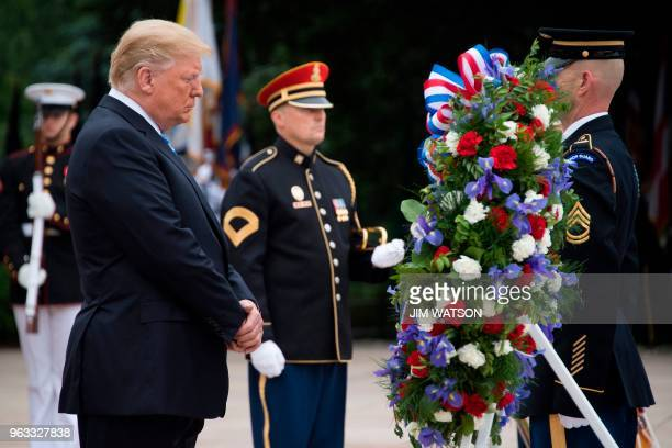 US President Donald Trump marks Memorial Day by laying a wreath at the Tomb of the Unknown Soldier at Arlington National Cemetery in Arlington...
