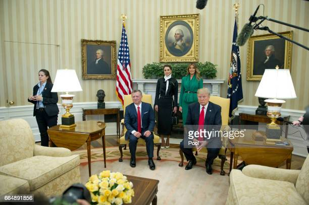US President Donald Trump meets King Abdullah II of Jordan in the Oval Office of the White House on April 5 2017 in Washington DC Standing behind the...