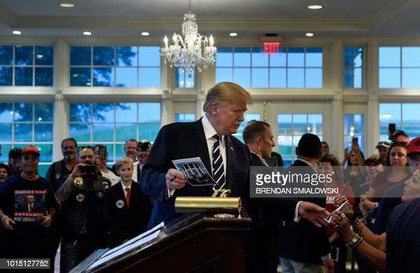 US President Donald Trump meets with a Bikers for Trump event at the Trump National Golf Club August 11 2018 in Bedminster New Jersey Trump welcomed...