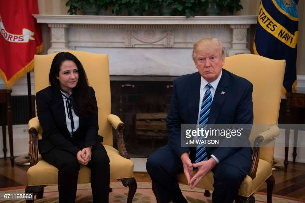 President Donald Trump meets with Aya Hijazi, an Egyptian-American aid worker at the White House in Washington, DC, April 21, 2017. Hijazi was flown...