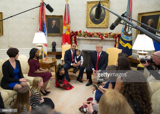 US President Donald Trump meets with business owners and their families to discuss tax reform in the Oval Office of the White House on December 5...