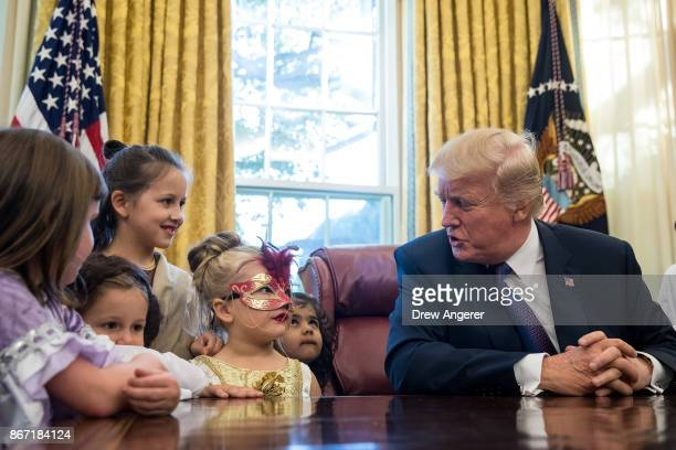S President Donald Trump meets with children of journalists and White House staffers in the Oval Office at the White House October 27 2017 in...