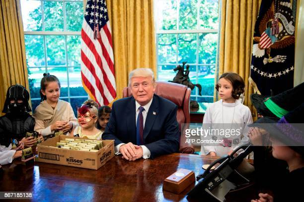 President Donald Trump meets with children of members of the press for Halloween in the Oval Office of the White House in Washington, DC, on October...