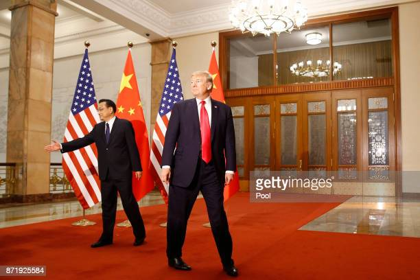 S President Donald Trump meets with China's Premier Li Keqiang before a meeting at the Great Hall of the People on November 9 2017 in Beijing China...