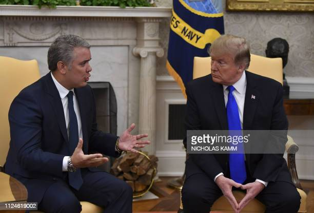US President Donald Trump meets with Colombian President Ivan Duque in the Oval Office at the White House in Washington DC on February 13 2019...