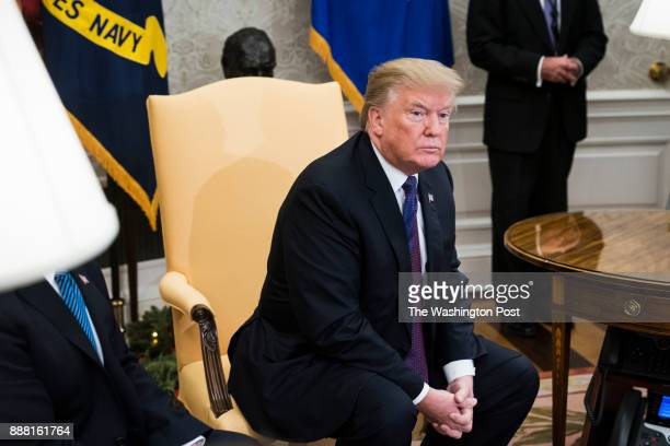 President Donald Trump meets with congressional leaders including House Minority Leader Nancy Pelosi of Calif left House Speaker Paul Ryan of Wis...