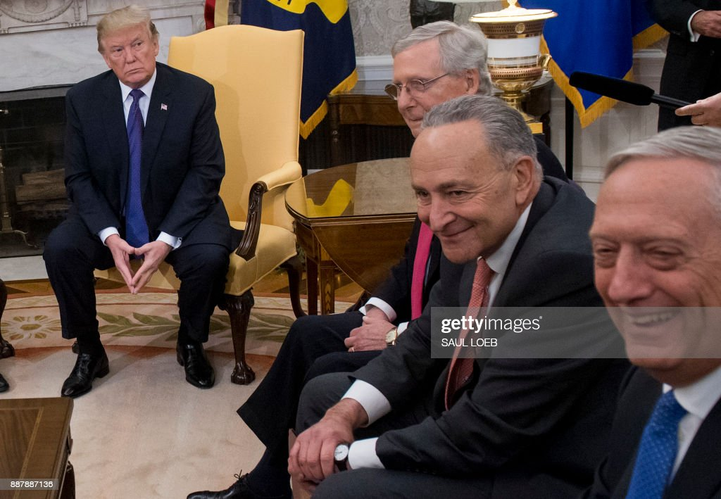 US President Donald Trump, meets with Congressional leadership including Senate Majority Leader Mitch McConnell (2nd L), Republican of Kentucky, and Senate Minority Leader Chuck Schumer (2nd R), and Secretary of Defense Jim Mattis (R), in the Oval Office at the White House in Washington, DC, December 7, 2017. /
