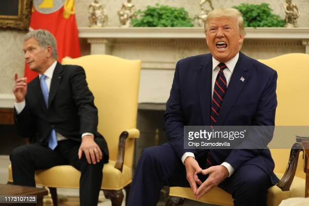 President Donald Trump meets with Finnish President Sauli Niinisto in the Oval Office of the White House on October 02, 2019 in Washington, DC. The...