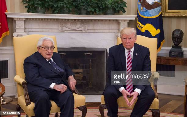 President Donald Trump meets with former Secretary of State Henry Kissinger in the Oval Office at the White House on May 10 2017 in Washington DC