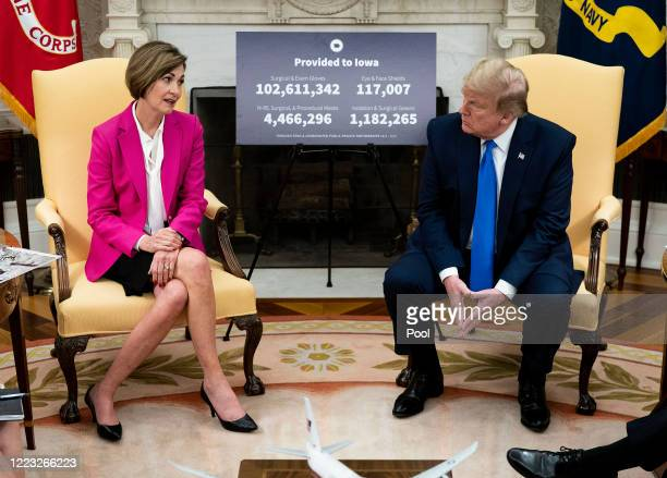S President Donald Trump meets with Iowa Governor Kim Reynolds in the Oval Office at the White House as he continues to promote reopening business...