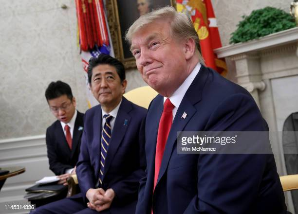 S President Donald Trump meets with Japanese Prime Minister Shinzo Abe in the Oval Office of the White House April 26 2019 in Washington DC Trump and...