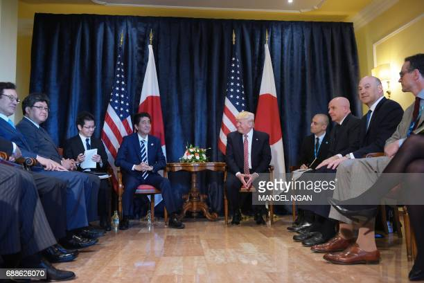US President Donald Trump meets with Japanese Prime Minister Shinzo Abe during a bilateral meeting at the Villa Diodoro on the sidelines of the...